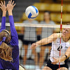Richi Bigelow of CU hits the ball against Furman.<br /> Cliff Grassmick / August 27, 2010
