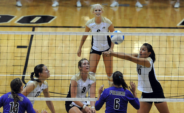 Anicia Santos (10) hits the ball up for CU teammates against Furman.<br /> Cliff Grassmick / August 27, 2010