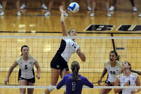 Nichole Lindow (15)  of Colorado hits past Phoebe Maglathlin of Furman.<br /> Cliff Grassmick / August 27, 2010