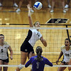 Nichole Lindow (15)  of Colorado hits past Phoebe Maglathlin of Furman.<br /> Cliff Grassmick / August 27, 2010