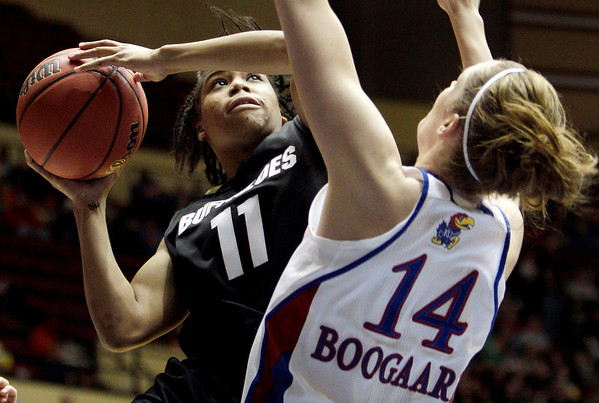 Colorado's Brittany Wilson, left, heads to the basket as Kansas' Krysten Boogaard defends during the second half of an NCAA college basketball game at the Big 12 Conference women's tournament on Tuesday, March 8, 2011, in Kansas City, Mo. Kansas won 71-45. (AP Photo/Jeff Roberson)