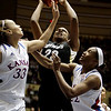 Colorado's Brittany Spears, center, heads to the basket as Kansas' Tania Jackson, left, and Marisha Brown defend during the second half of an NCAA college basketball game at the Big 12 Conference women's tournament on Tuesday, March 8, 2011, in Kansas City, Mo. Kansas won 71-45. (AP Photo/Jeff Roberson)