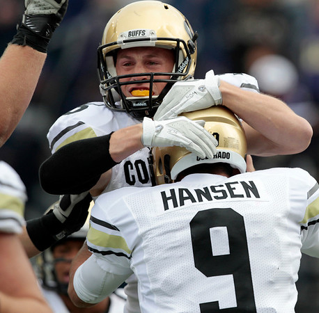 Colorado quarterback Tyler Hansen (9) celebrates with Kyle Cefalo after Cefalo caught a 5-yard touchdown pass against Washington in the first half of an NCAA college football game, Saturday, Oct. 15, 2011, in Seattle. (AP Photo/Elaine Thompson)