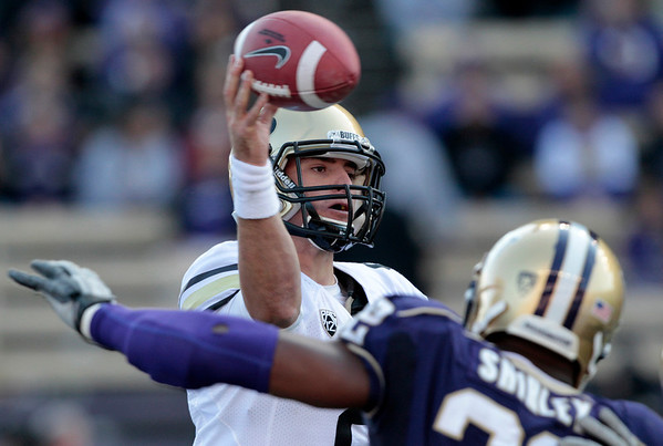 Colorado quarterback Tyler Hansen passes under pressure from Washington's Josh Shirley in the second half of an NCAA college football game, Saturday, Oct. 15, 2011, in Seattle. Washington won 52-24. (AP Photo/Elaine Thompson)