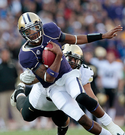 Washington quarterback Keith Price scrambles against Colorado in the first half of an NCAA college football game Saturday, Oct. 15, 2011, in Seattle. Washington won 54-24. (AP Photo/Elaine Thompson)