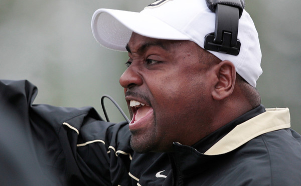 Colorado coach Jon Embree directs his team against Washington in the first half of an NCAA college football game, Saturday, Oct. 15, 2011, in Seattle. (AP Photo/Elaine Thompson)