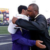 Colorado coach Jon Embree, right, embraces Washington coach Steve Sarkisian after an NCAA college football game, Saturday, Oct. 15, 2011, in Seattle. Washington won 52-24. (AP Photo/Elaine Thompson)