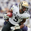 Colorado's Rodney Stewart carries against Washington early in the first half of an NCAA college football game, Saturday, Oct. 15, 2011, in Seattle. Stewart left the game later in the half with a knee injury. Washington won 52-24. (AP Photo/Elaine Thompson)