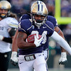 Washington's Jesse Callier runs 26-yards for a touchdown against Colorado in the second half of an NCAA college football game, Saturday, Oct. 15, 2011, in Seattle. Washington won 52-24. (AP Photo/Elaine Thompson)