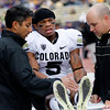 Colorado's Rodney Stewart is treated by trainers on the sidelines in the first half of an NCAA college football game against Washington, Saturday, Oct. 15, 2011, in Seattle. (AP Photo/Elaine Thompson)