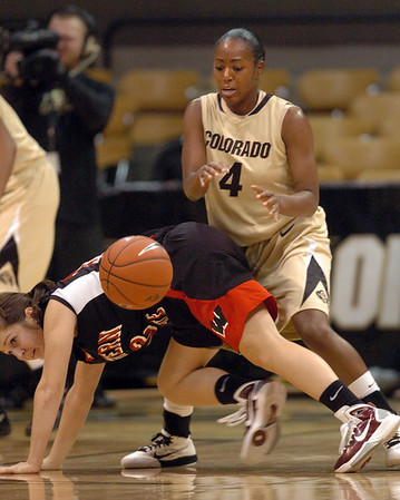 Britney Blythe (4) of Colorado, knocks the ball from Krista Cona of Western State.<br /> Cliff Grassmick / November 5, 2010