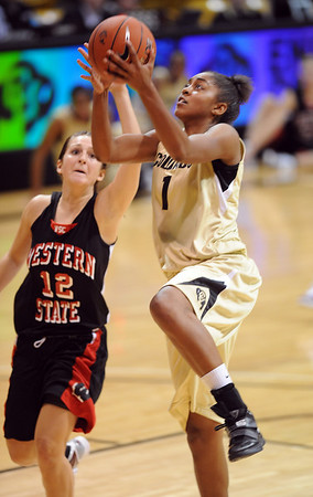 Shae Kelley of CU shoots over Krista Cona  of Western State.<br /> Cliff Grassmick / November 5, 2010