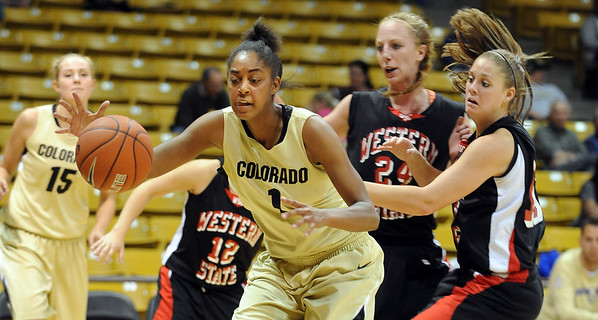 Shae Kelley of CU  looks to shoot over Kerstom Minchow and others  of Western State.<br /> Cliff Grassmick / November 5, 2010