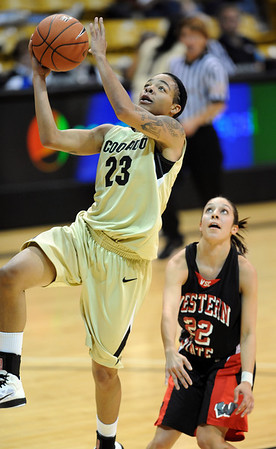 Chucky Jeffery of CU scores past Nikki Trujillo of Western State.<br /> Cliff Grassmick / November 5, 2010