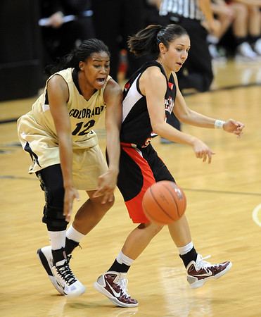 Ashley Wilson of CU knocks the ball away from Nikki Trujillo of Western State.<br /> Cliff Grassmick / November 5, 2010
