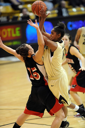 Shae Kelley of Colorado drives into Katie Hall of Western State.<br /> Cliff Grassmick / November 5, 2010