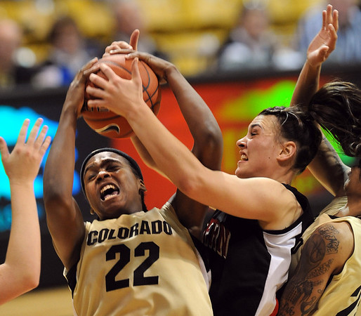 Brittany Spears (22) of CU rips the rebound from Katie Hall of Western State.<br /> Cliff Grassmick / November 5, 2010