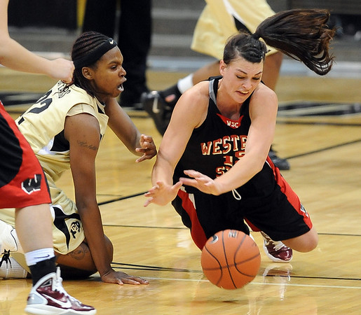 Brittany Spears, left of CU, and Katie Hall of Western State, go to the floor for the ball.<br /> Cliff Grassmick / November 5, 2010