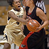 Britney Blythe (4) of Colorado, pressures Krista Cona of Western State.<br /> Cliff Grassmick / November 5, 2010