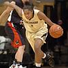 Shae Kelley, of CU, starts the fastbreak against Western State.<br /> Cliff Grassmick / November 5, 2010