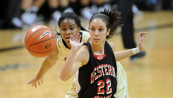 Ashley Wilson of CU knocks the ball away from Nikki Trujillo of Western State.<br /> Cliff Grassmick / November 5, 2010