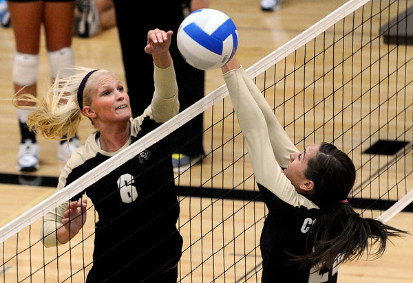 "University of Colorado's Kerra Schroeder, left, spikes the ball past teammate Erin Stock on Saturday, Aug. 20, during volleyball practice at the Coors Event Center on the CU campus in Boulder. For more photos of practice go to  <a href=""http://www.dailycamera.com"">http://www.dailycamera.com</a><br /> Jeremy Papasso/ Camera"