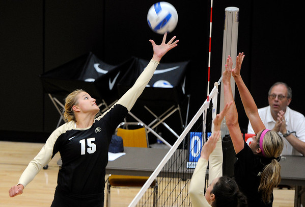 "University of Colorado's Nikki Lindow stretches to hit the ball on Saturday, Aug. 20, during volleyball practice at the Coors Event Center on the CU campus in Boulder. For more photos of practice go to  <a href=""http://www.dailycamera.com"">http://www.dailycamera.com</a><br /> Jeremy Papasso/ Camera"