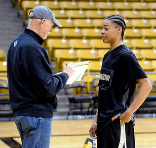 Chucky Jeffery, right, talks to the media on CU media day on Wednesday. For videos and photos of media day, go to www.dailycamera.com Cliff Grassmick / October 26, 2011
