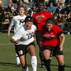 Kassidy Fitzpatrick, left, of CU, and Casey McCall of Texas Tech try to connect in front of the net.<br /> Cliff Grassmick / October 30, 2009