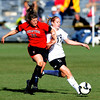 Casey McCall, left, of Texas Tech, tries to stop Nikki Marshall of CU as she attacks the goal.<br /> Cliff Grassmick / October 30, 2009