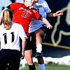 Leanne Mihelich, left of Texas Tech,  and  Quinn Krier of CU battle on the header.<br /> Cliff Grassmick / October 30, 2009