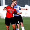 Haley Fowler, left, of Texas Tech, and Erin Bricker of CU, battle on the header on Friday.<br /> Cliff Grassmick / October 30, 2009