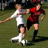 Nikki Marshall  of CU kicks toward the goal around Casey McCall of Texas Tech.<br /> Cliff Grassmick / October 30, 2009