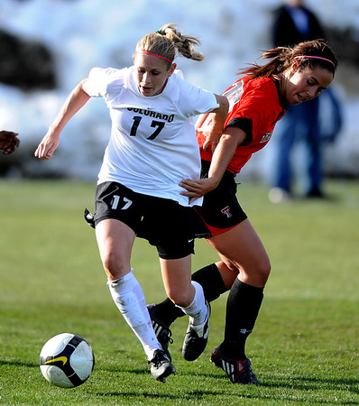 Nikki Marshall of CU works around Haley Fowler of Texas Tech in front  of the goal.<br /> Cliff Grassmick / October 30, 2009