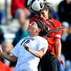 Kassidy Fitzpatrick, left, of CU and Zhaleh Rezaie of Texas Tech battle on the header.<br /> Cliff Grassmick / October 30, 2009
