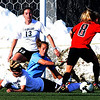Madison Terry (8) of Texas Tech, tries to score on Amy Barczuk, bottom, Kara Linder and Kate Russell (13) all of CU.<br /> Cliff Grassmick / October 30, 2009