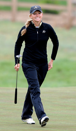 """Emily Talley of CU has a smile for her family at hole 16 during the 3rd round of the West Regional.<br /> For more photos of the 3rd round, go to  <a href=""""http://www.dailycamera.com"""">http://www.dailycamera.com</a>.<br /> Cliff Grassmick / May 12, 2012"""