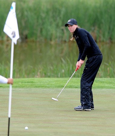 "Jennifer Coleman of CU hits a putt at hole 16 in 3rd round action.<br /> For more photos of the 3rd round, go to  <a href=""http://www.dailycamera.com"">http://www.dailycamera.com</a>.<br /> Cliff Grassmick / May 12, 2012"
