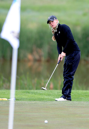 "Emily Talley of CU watches her putt at hole 16 during the 3rd round of the West Regional.<br /> For more photos of the 3rd round, go to  <a href=""http://www.dailycamera.com"">http://www.dailycamera.com</a>.<br /> Cliff Grassmick / May 12, 2012"