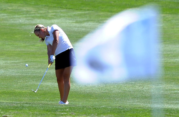 "Emily Talley of CU hitting toward the flag at hole 17.<br /> For more photos of the West Regional, go to  <a href=""http://www.dailycamera.com"">http://www.dailycamera.com</a><br /> Cliff Grassmick / May 10, 2012"