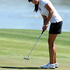 "Jessica Wallace of CU watches a putt at hole 17 on Thursday.<br /> For more photos of the West Regional, go to  <a href=""http://www.dailycamera.com"">http://www.dailycamera.com</a><br /> Cliff Grassmick / May 10, 2012"