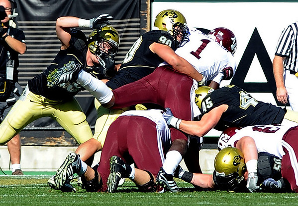 "Marquez Herrod and CU company stop Jerrod Johnson  of Texas A & M on 4th and goal.<br /> For more photos from the game, go to  <a href=""http://www.dailycamera.com"">http://www.dailycamera.com</a>.<br /> Cliff Grassmick / November 7, 2009"