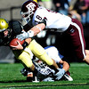 University of Colorado's Tyler Hansen is tackled by Texas A&M's Kyle Mngna (18) during the game at Folsom Field on the University of Colorado campus in Boulder, Saturday, Nov. 7,  2009. <br /> KASIA BROUSSALIAN / THE CAMERA