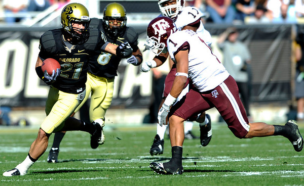 University of Colorado's Scotty McKnight (21) looks towards Texas A&M's Trent Hunter (1) as Hunter comes in for a tackle during the game at Folsom Field on the University of Colorado campus in Boulder, Saturday, Nov. 7,  2009. <br /> KASIA BROUSSALIAN / THE CAMERA