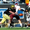 "Curtis Cunningham of Colorado, almost comes up with an interception against the Aggies.<br /> <br /> For more photos from the game, go to  <a href=""http://www.dailycamera.com"">http://www.dailycamera.com</a>.<br /> Cliff Grassmick / November 7, 2009"