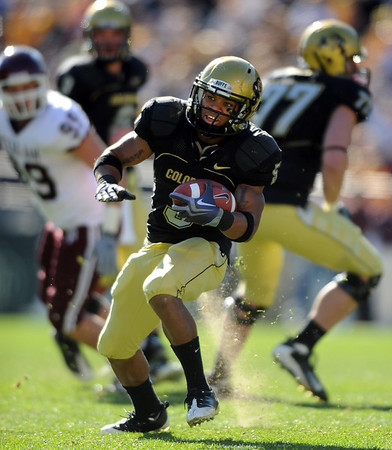 """Rodney Stewart of Colorado had two touchdowns against Texas A & M on Saturday to help the Buffs win 35-34.<br /> <br /> For more photos from the game, go to  <a href=""""http://www.dailycamera.com"""">http://www.dailycamera.com</a>.<br /> Cliff Grassmick / November 7, 2009"""