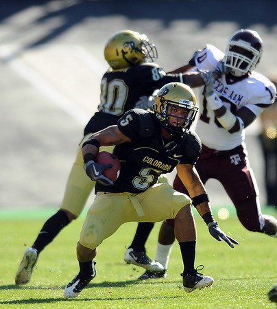 """Rodney Stewart of Colorado had two touchdowns against Texas A & M on Saturday to help the Buffs win 35-34.<br /> For more photos from the game, go to  <a href=""""http://www.dailycamera.com"""">http://www.dailycamera.com</a>.<br /> Cliff Grassmick / November 7, 2009"""