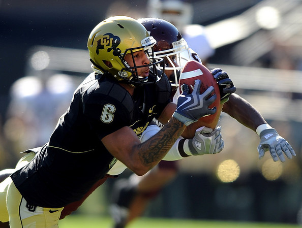 """Markques Simas of CU pulls in a circus catch against the Aggies to set up a Buff touchdown. Jordan Pugh of the Aggies is defending.<br /> For more photos from the game, go to  <a href=""""http://www.dailycamera.com"""">http://www.dailycamera.com</a>. <br /> Cliff Grassmick / November 7, 2009"""