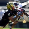 "Markques Simas of CU pulls in a circus catch against the Aggies to set up a Buff touchdown. Jordan Pugh of the Aggies is defending.<br /> For more photos from the game, go to  <a href=""http://www.dailycamera.com"">http://www.dailycamera.com</a>. <br /> Cliff Grassmick / November 7, 2009"