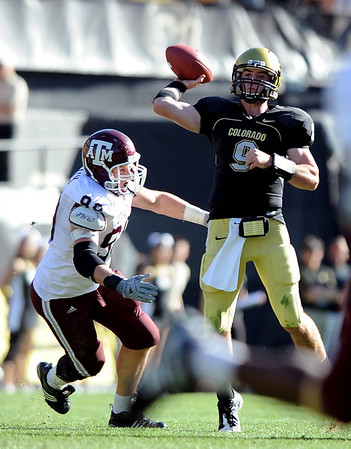 "CU QB Tyler Hansen of CU  goes to the air against Texas A & M in the Colorado 35-34 win.<br /> <br /> For more photos from the game, go to  <a href=""http://www.dailycamera.com"">http://www.dailycamera.com</a>.<br /> Cliff Grassmick / November 7, 2009"